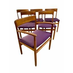 Set of 6 danish teak wood dining chairs with purple seats.