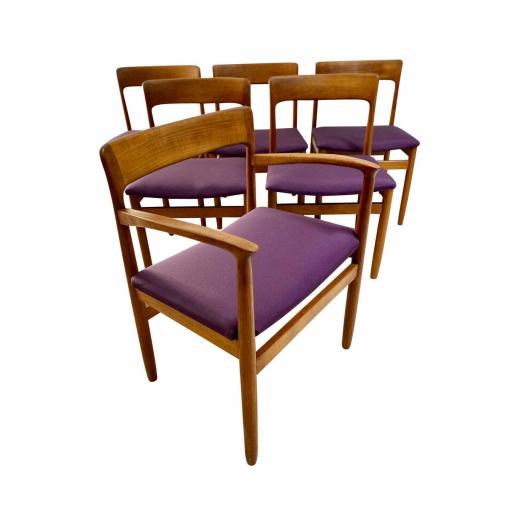 Set of 6 danish teak wood dining chairs with purple seats.