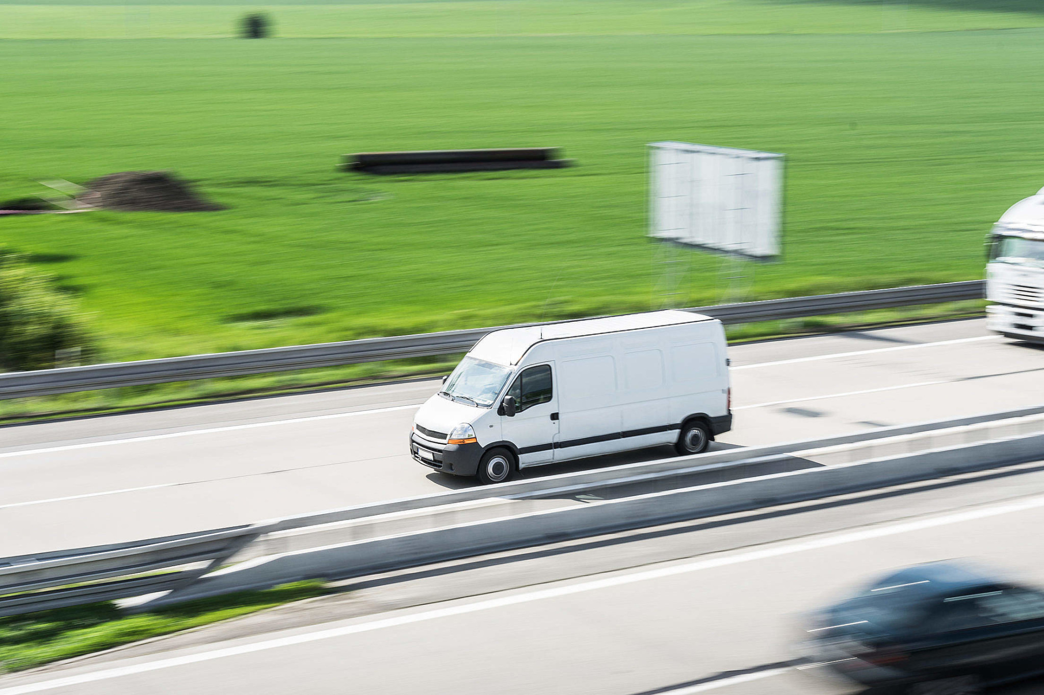 white-delivery-van-in-motion-driving-on-highway_free_stock_photos_picjumbo_DSC04216-2210x1473.jpg