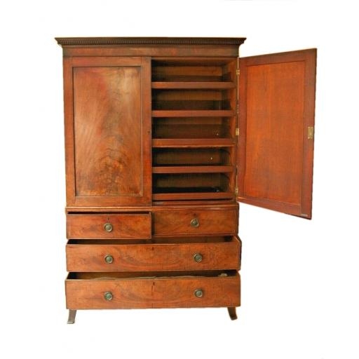 An early 19th century flame mahogany linen press / cupboard / drawers