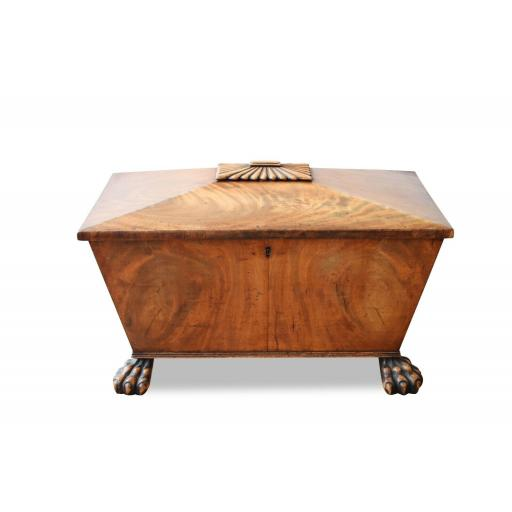 A William IV mahogany sarcophagus cellarette on front lion paw feet